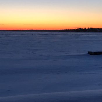 Water & Wastewater Servicing Feasibility Study - A frozen lake at sunset
